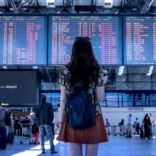 Woman at airport travelling to countries